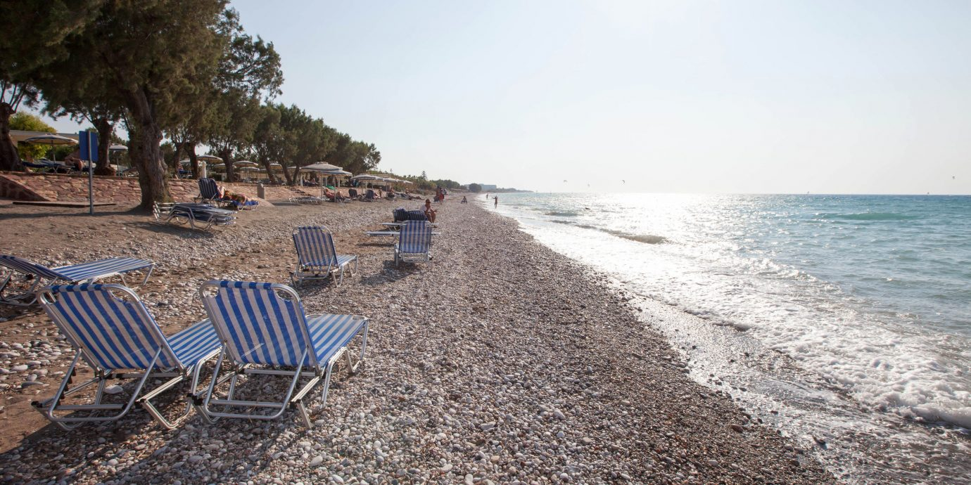 ground sky Beach chair shore Sea Coast Nature Ocean walkway sand lawn empty day sandy seat sunny lined line