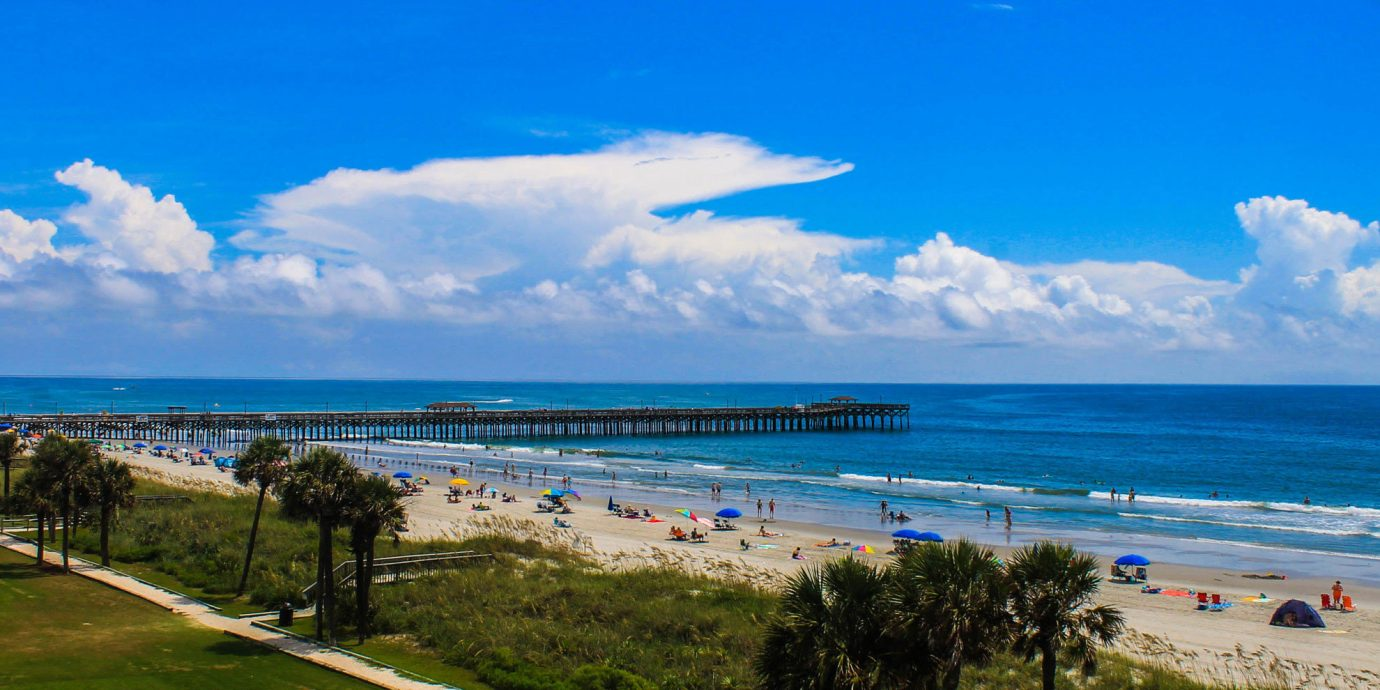 sky grass shore Nature Sea Coast Beach horizon Ocean cloud caribbean cape day