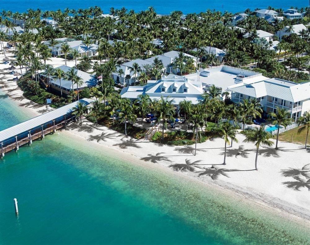 tree Resort leisure property marina Beach swimming pool caribbean Water park dock Nature resort town condominium Sea Lagoon shore