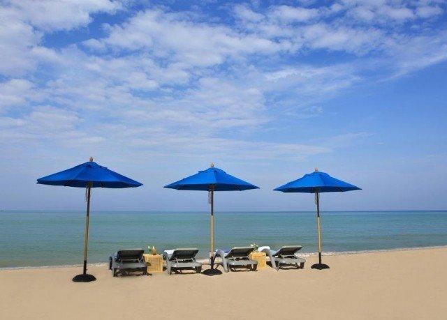 umbrella sky chair Beach blue natural environment Nature Ocean shore Sea couple lawn day shade lined sandy