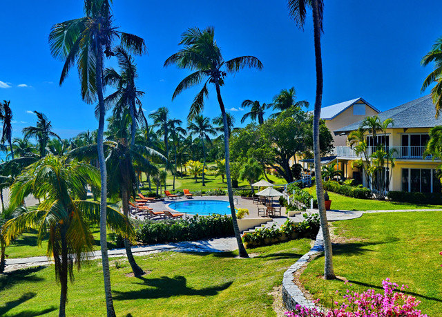 tree grass sky palm leisure Resort plant arecales tropics caribbean lawn Beach swimming pool lined