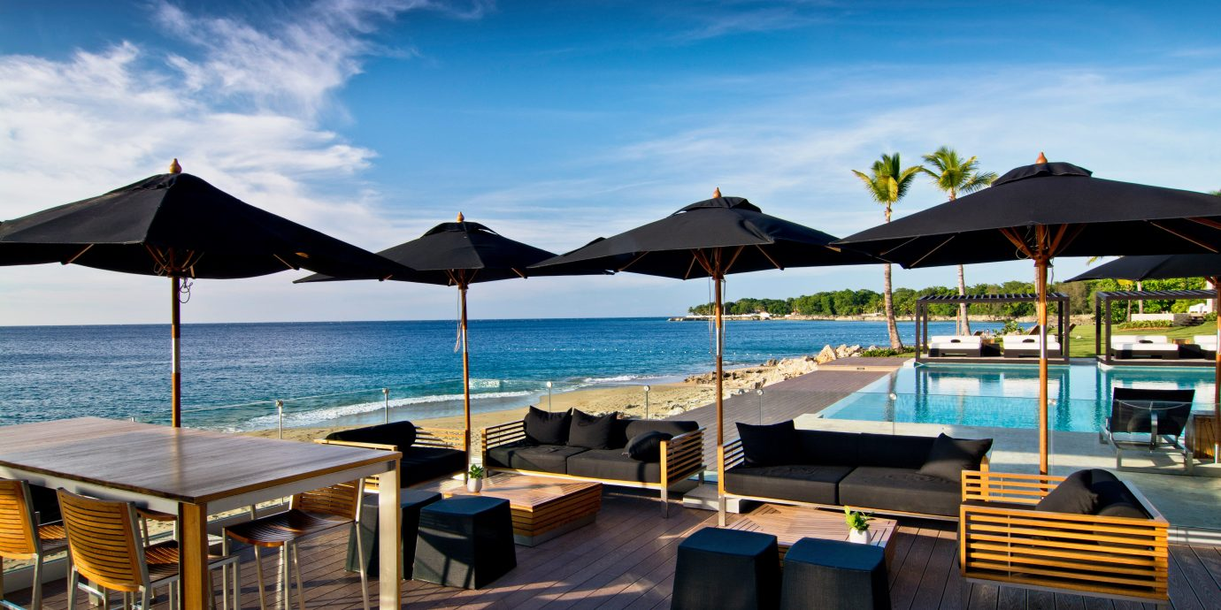 Beachfront Deck Dining Luxury Pool umbrella sky chair water leisure lawn Resort swimming pool set dock Sea empty shore lined day