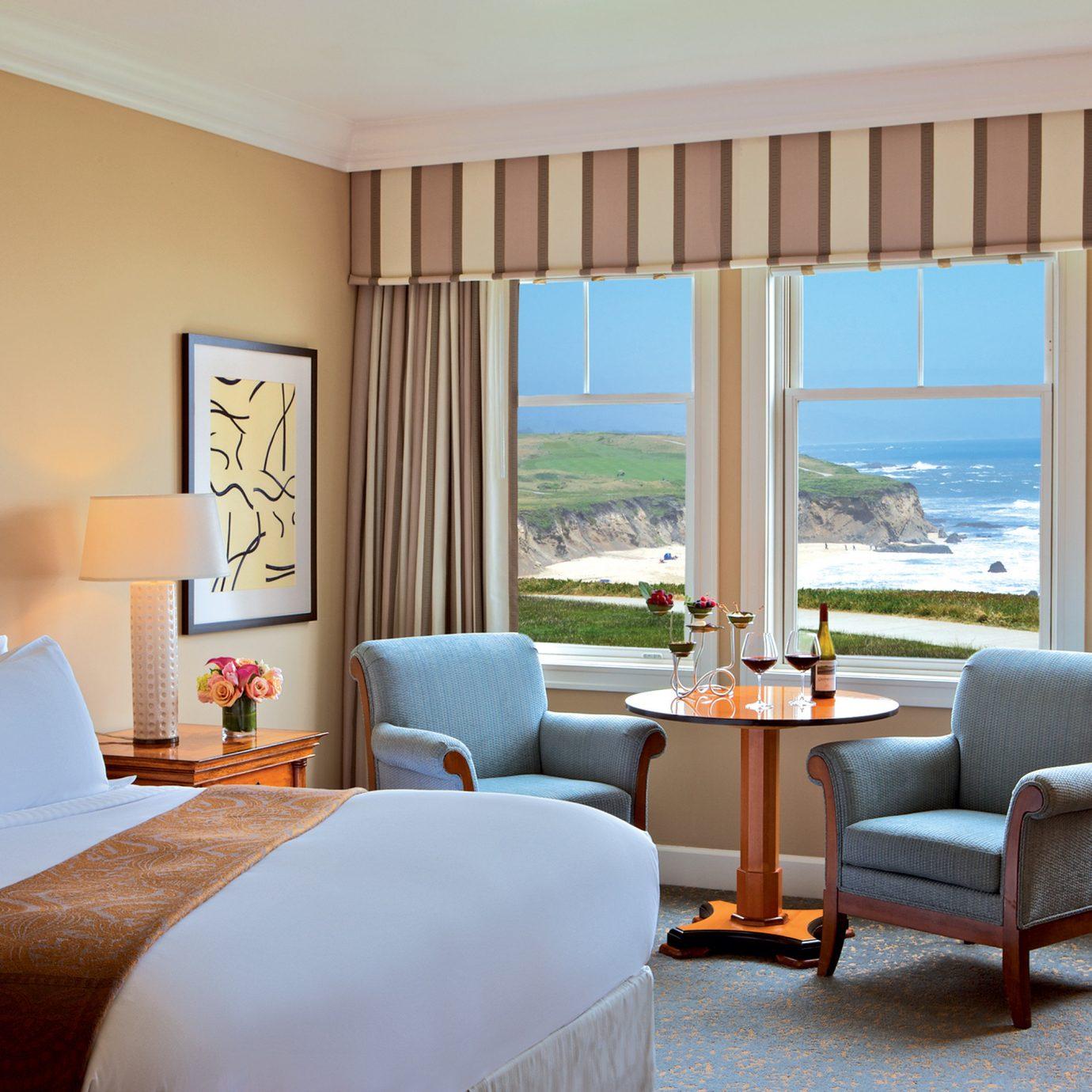 Bedroom Hotels Lounge Luxury Modern Scenic views Suite chair property Resort home living room nice cottage condominium Villa