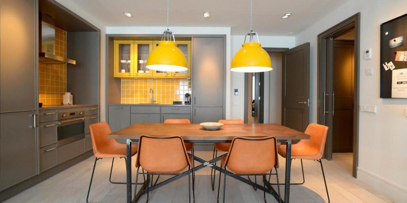 property living room home hardwood Kitchen cabinetry orange condominium Bedroom