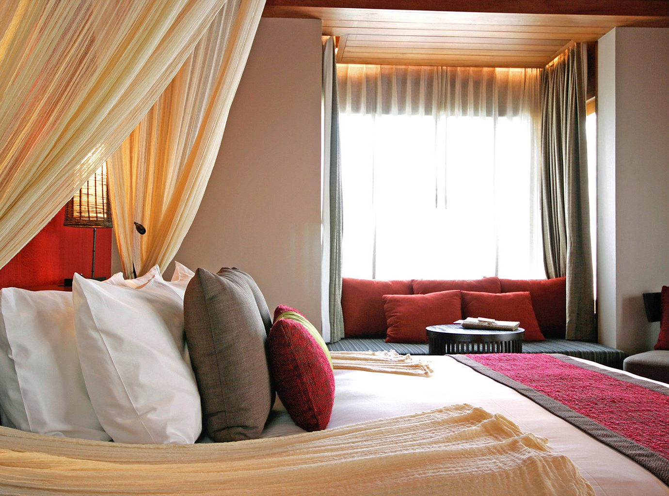 Bedroom Luxury Modern Scenic views Suite property red pillow curtain cottage