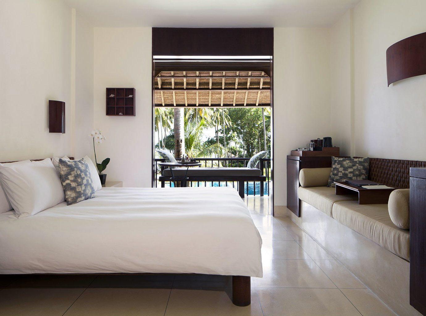 sofa property Bedroom living room home Suite hardwood condominium Villa cottage