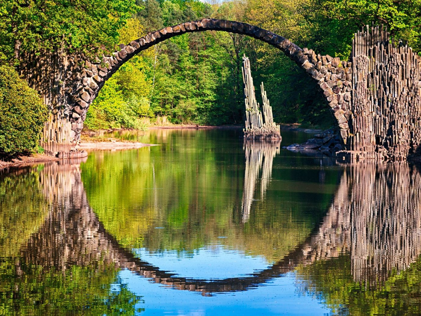 Trip Ideas tree outdoor grass water reflection River body of water bridge Lake woody plant flower pond Nature waterway autumn surrounded wetland stream park way arch wooded