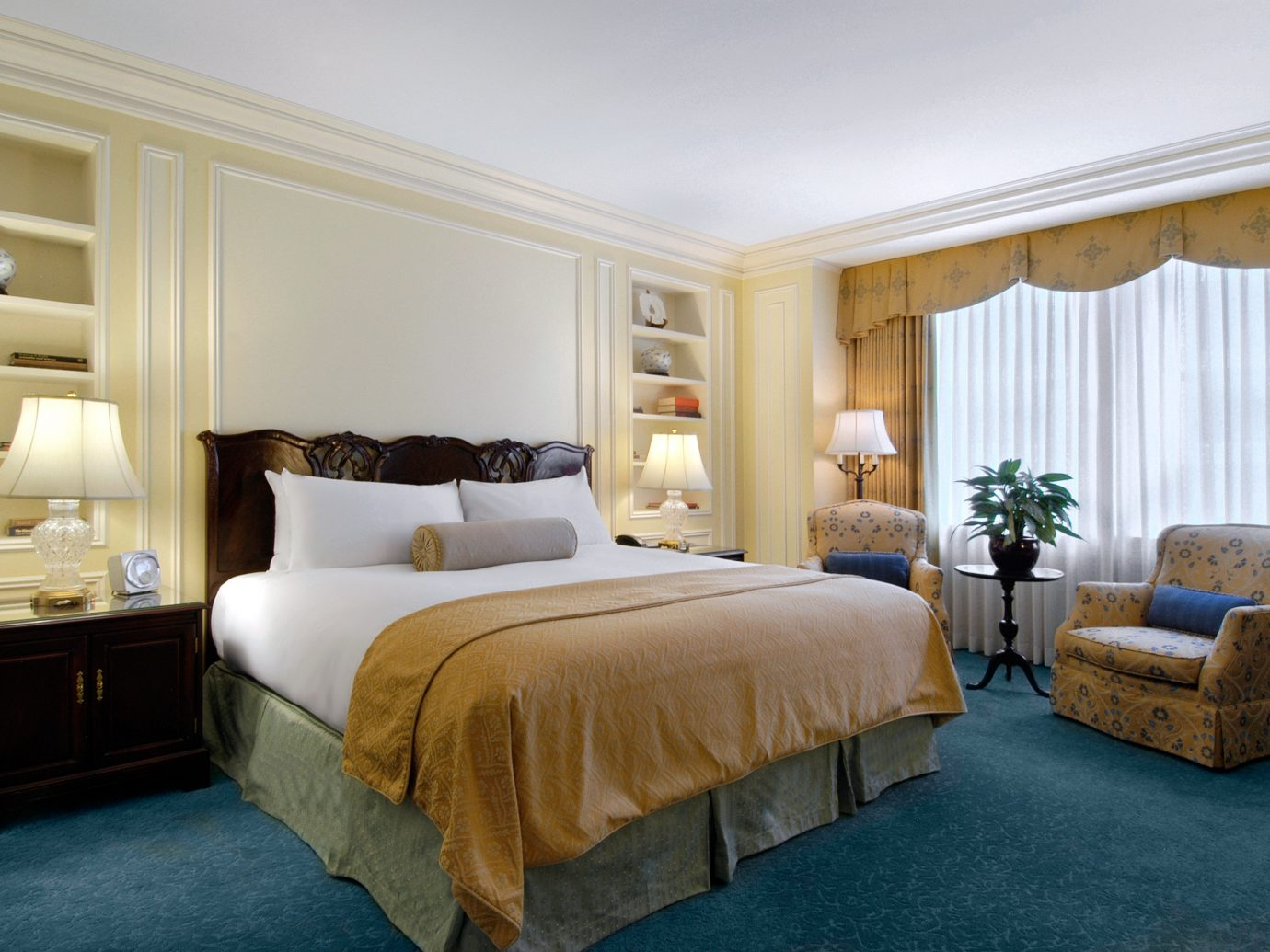 Bedroom Classic Historic Hotels Suite bed indoor floor wall room hotel property ceiling estate interior design home real estate living room furniture cottage containing