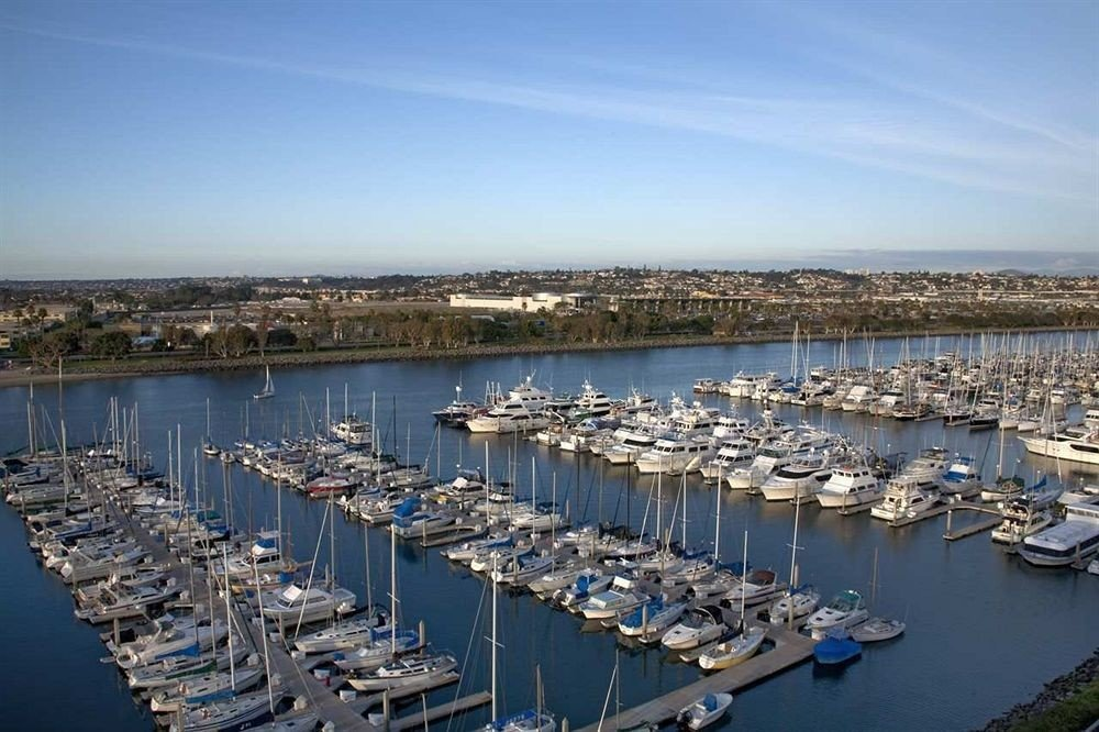 water sky marina row lined dock many Harbor Boat port lots bunch scene vehicle line Sea channel infrastructure full docked