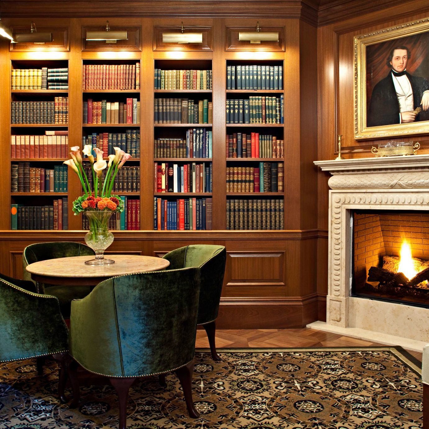 Boutique Hotels Fireplace Hotels Lounge chair home living room cabinetry shelf hardwood mansion