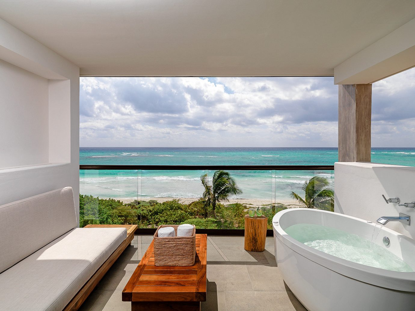 Boutique Hotels Hotels Luxury Travel property Sea swimming pool Resort bathtub sky Ocean Villa condominium amenity penthouse apartment house overlooking Island