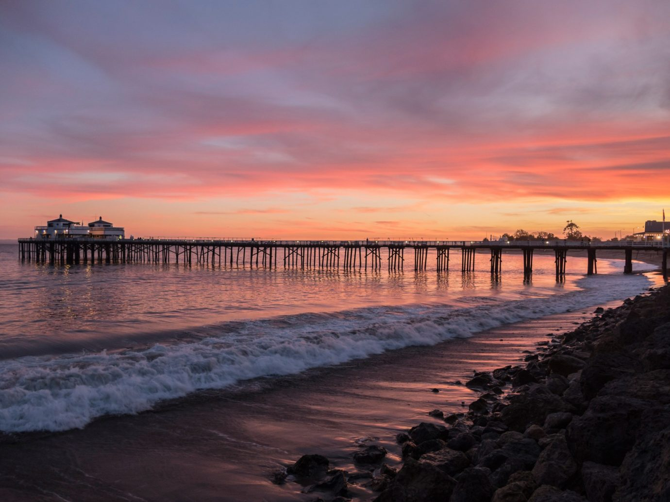Jetsetter Guides outdoor sky water scene pier Beach Sunset Sea shore sunrise Coast body of water Ocean dawn cloud horizon dusk evening wave morning afterglow reflection bay wind wave sandy several
