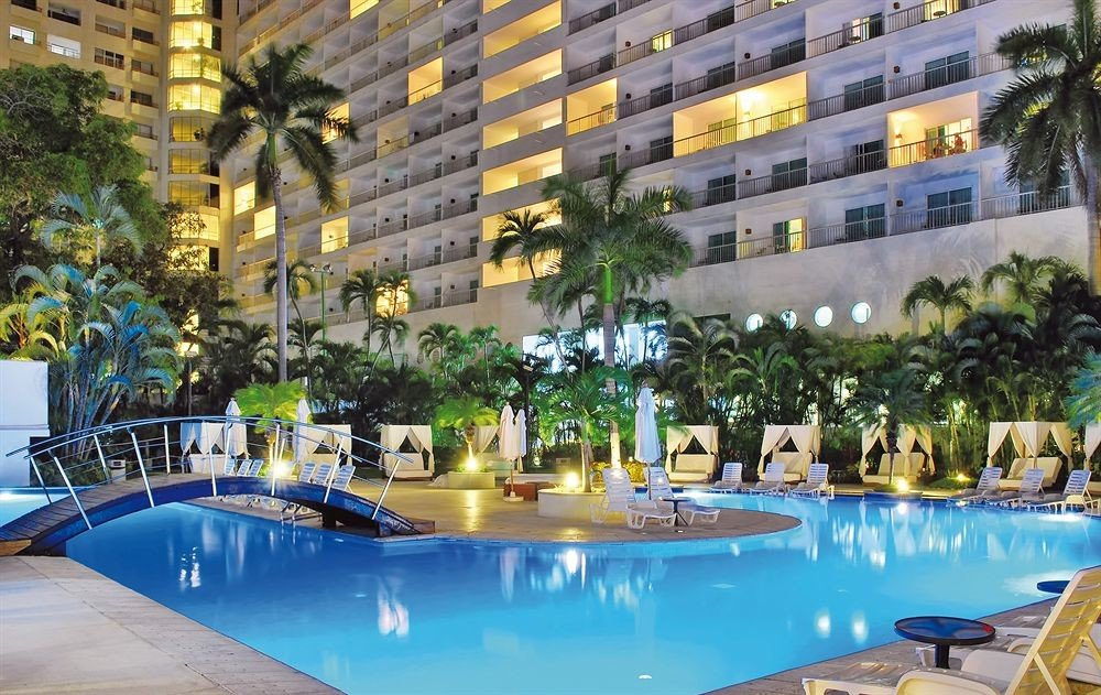 Budget Family Pool Resort Tropical condominium swimming pool leisure property plaza resort town blue