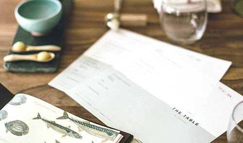 Food + Drink table indoor cash money document brand writing label