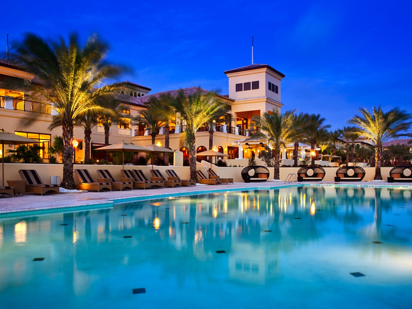 All-Inclusive Resorts Hotels Trip Ideas sky outdoor Resort water leisure reflection swimming pool resort town palm tree arecales vacation hotel real estate estate tourism evening tropics Harbor Villa home caribbean tree computer wallpaper lined
