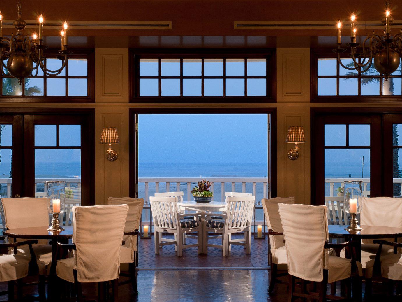 Bar Dining Drink Eat Hotels Luxury Modern indoor window floor ceiling restaurant estate Resort home interior design Design overlooking Island several dining room