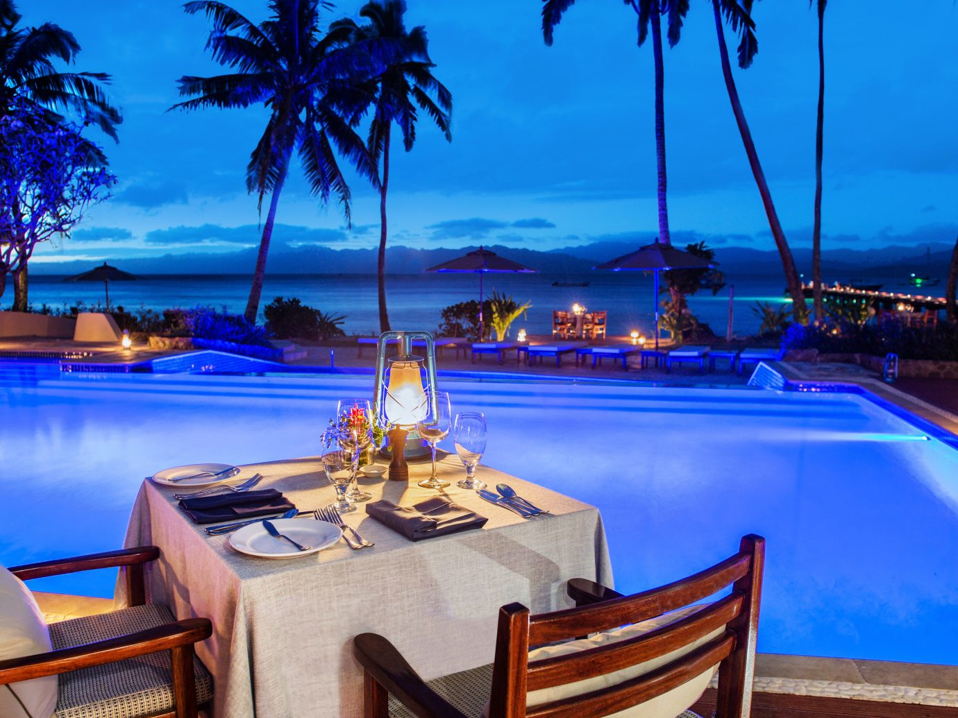 All-Inclusive Resorts Boutique Hotels Hotels Romance tree sky outdoor Resort chair swimming pool leisure palm tree resort town vacation tropics arecales water lighting caribbean evening Sea tourism estate hotel Villa restaurant amenity set furniture