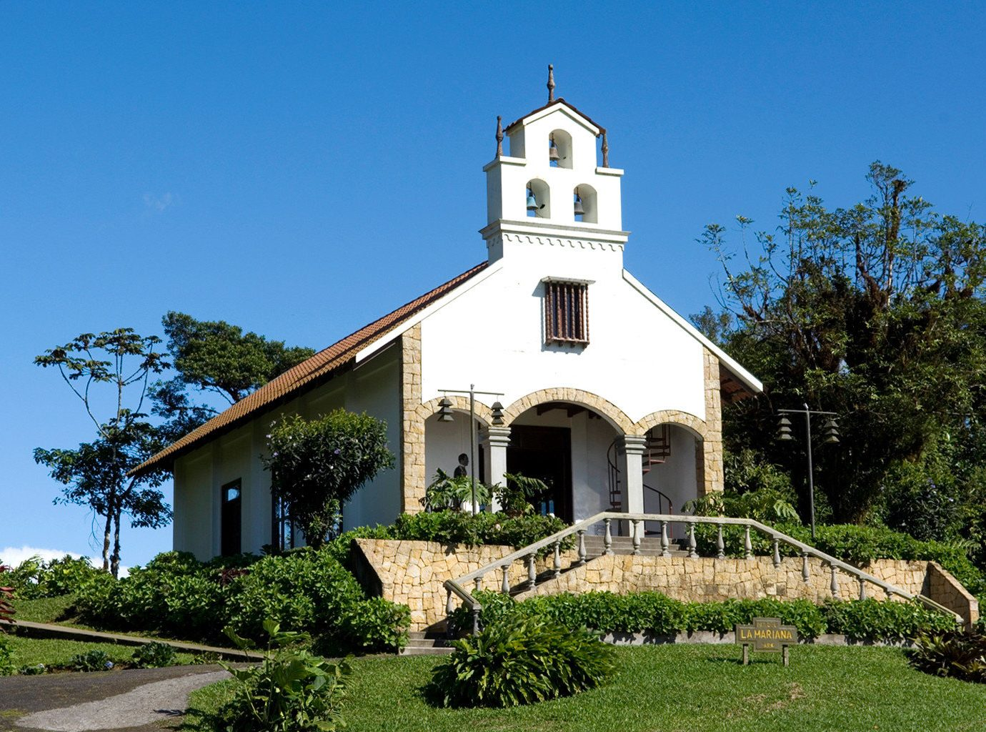 Country Historic Rustic tree sky grass building house tower Church place of worship brick chapel monastery spanish missions in california residential Villa Garden old Town stone