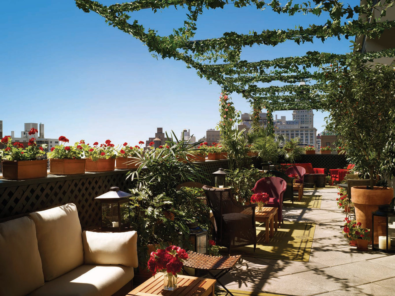 City Design Hotels Lounge NYC Outdoors Patio Rooftop Trip Ideas tree Living furniture flower backyard home estate yard outdoor structure Garden restaurant cottage Resort decorated area several