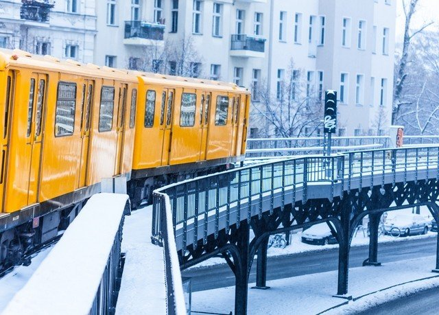yellow transport metropolitan area train vehicle public transport City Winter snow rolling stock season orange traveling