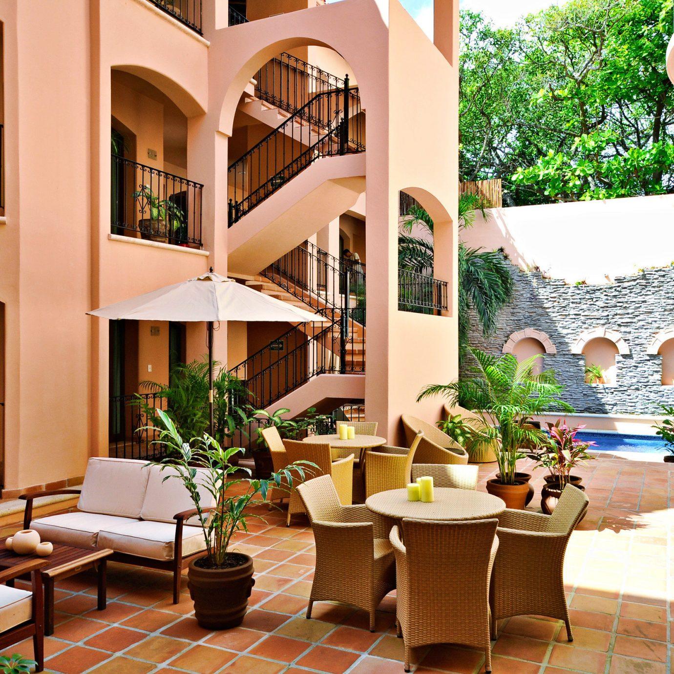 Dining Lounge Patio chair property home Resort condominium Lobby living room Villa Courtyard