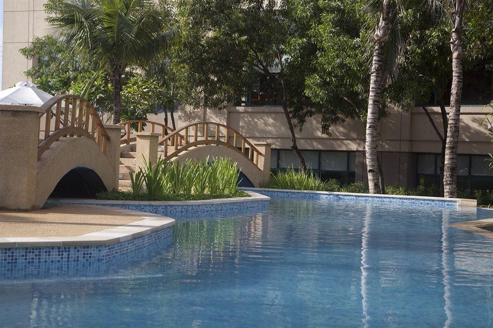 tree swimming pool property Resort reflecting pool backyard Villa water feature mansion thermae Courtyard stone