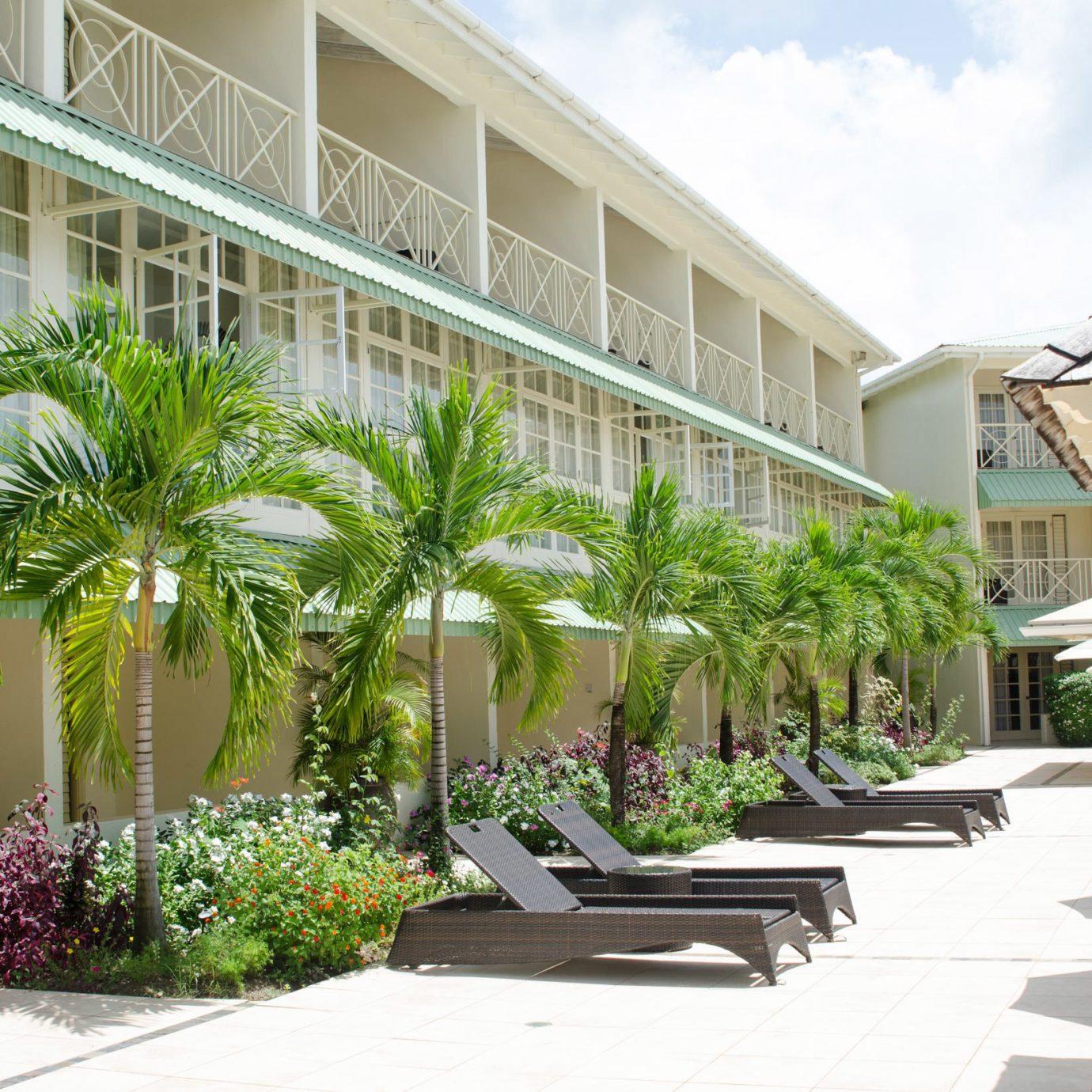 sky building condominium property Resort Courtyard plaza home residential area plant Villa walkway outdoor structure porch