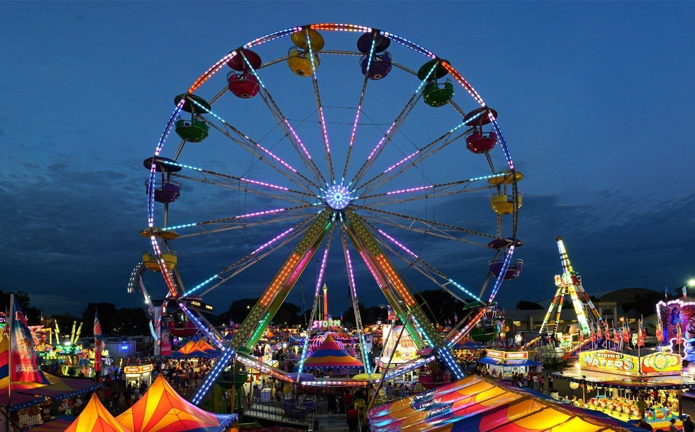 Offbeat ferris wheel amusement park fair tourist attraction park leisure outdoor recreation recreation ride colorful