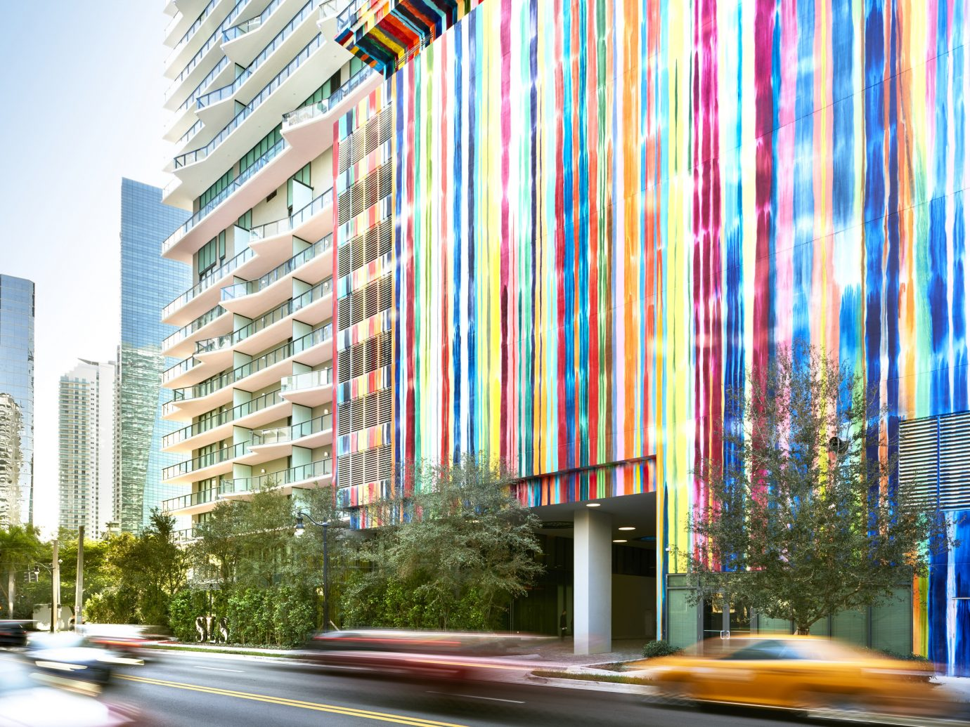 Hotels outdoor urban area Architecture interior design facade Downtown condominium lighting City skyscraper tower block window covering colorful lined tall