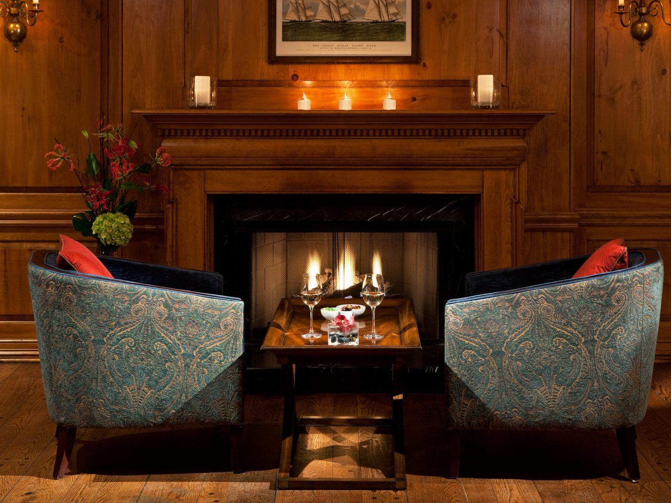Hip Hotels Living Lounge Luxury Modern indoor floor Fireplace room hearth living room hardwood wood lighting interior design home estate wood flooring furniture