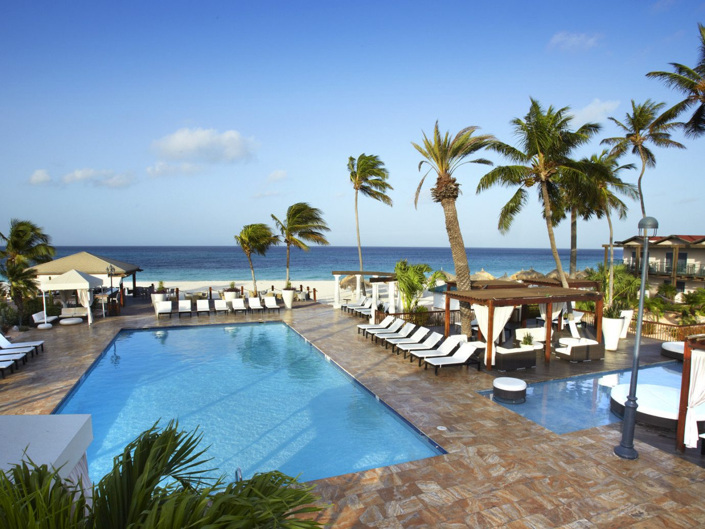 Hotels Romance tree outdoor sky water umbrella Resort chair palm swimming pool Beach property leisure estate vacation Pool Villa caribbean condominium real estate resort town furniture bay lawn Deck marina lined shore swimming several Island