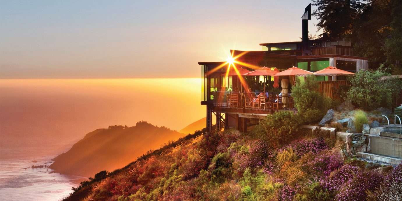 Food + Drink Hotels Romance outdoor sky Nature Coast mountain morning vacation evening landscape Sunset Sea dusk traveling hillside
