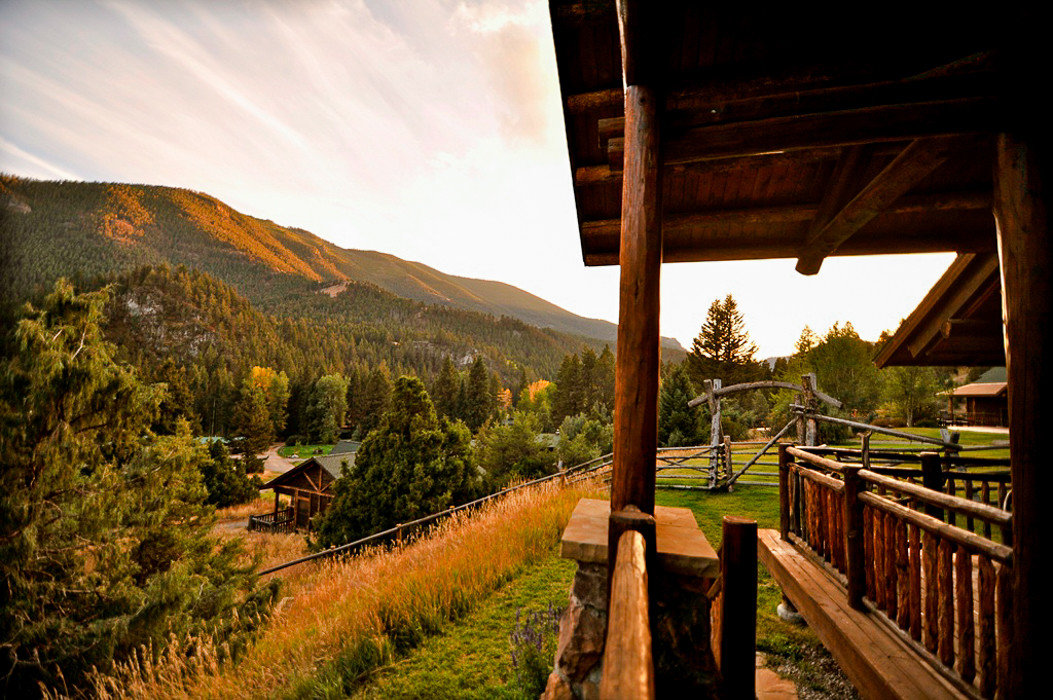 Glamping Hotels Montana Outdoors + Adventure Trip Ideas Nature sky tree wilderness plant mountain morning landscape sunlight hill cloud rural area evening wood grass national park house
