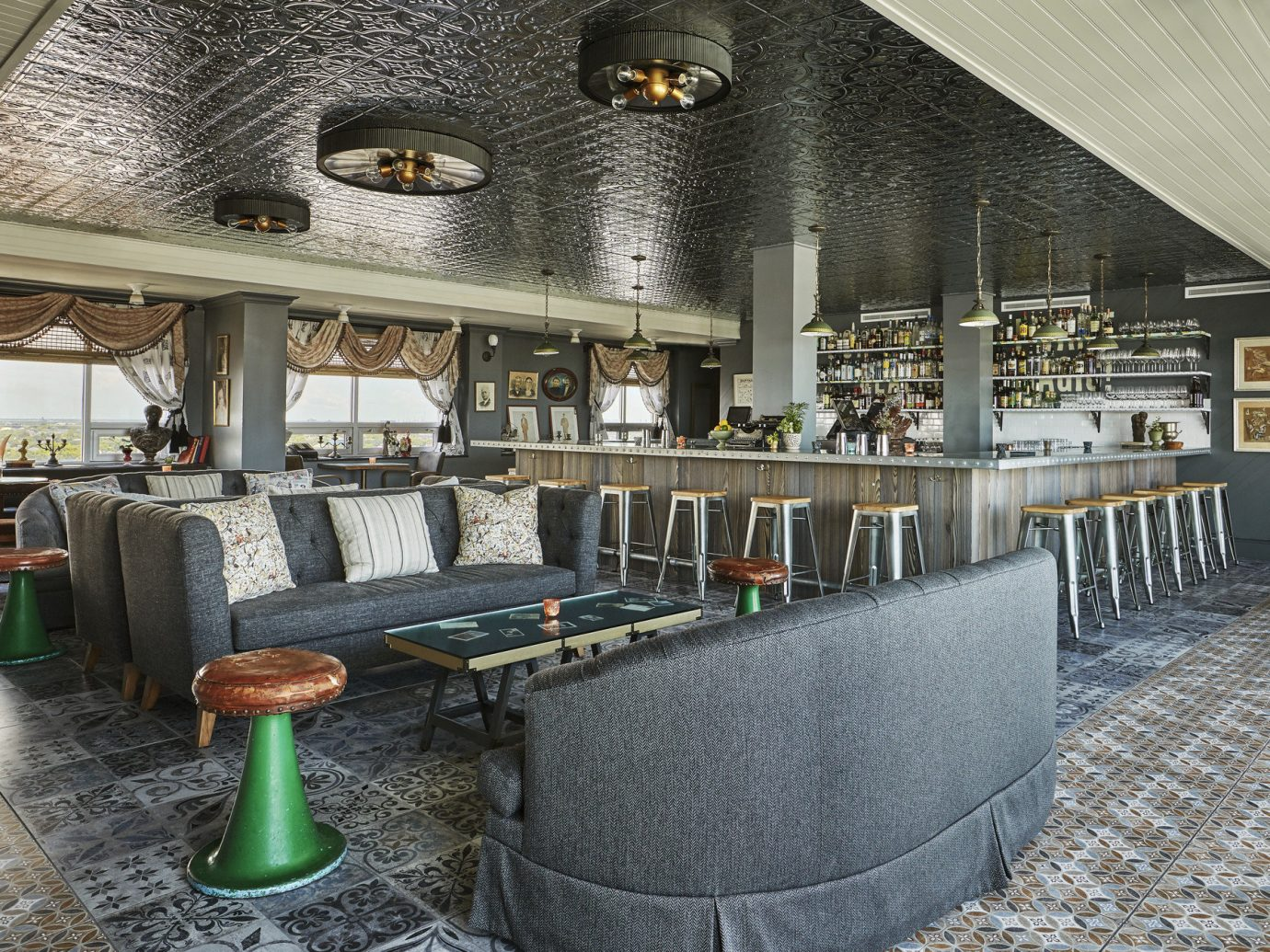 artistic artsy Bar bar seating charming cozy Girls Getaways Hip Hotels Lounge natural light New Orleans quaint quirky seating tables trendy Trip Ideas view Weekend Getaways estate interior design restaurant area