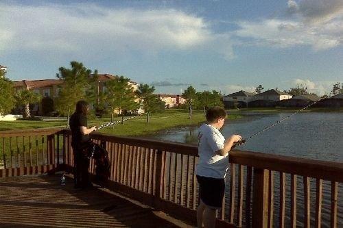 Fence sky property wooden railing walkway outdoor structure waterway overlooking shore Deck