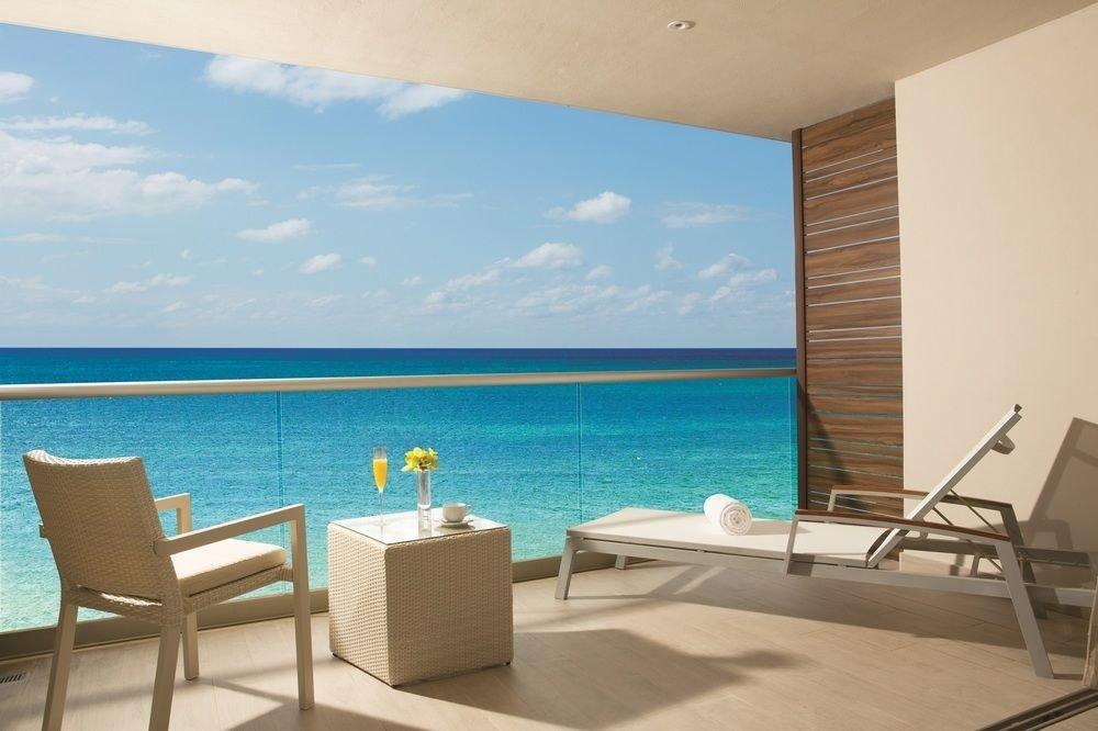 chair water property swimming pool Villa condominium caribbean Suite Resort cottage Deck shore Island