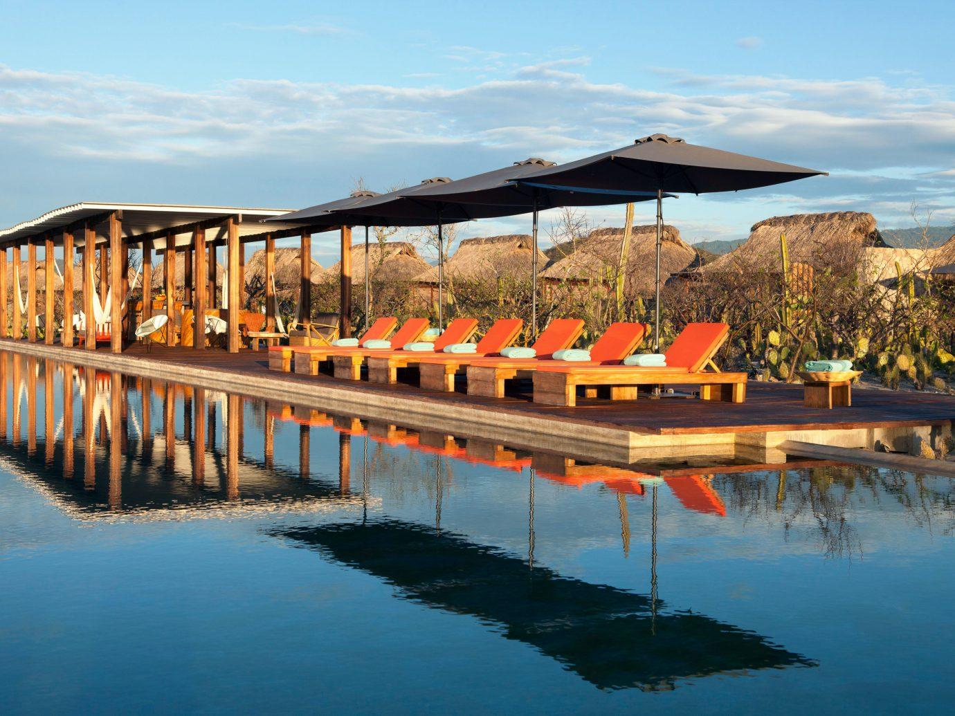 Deck Lounge Luxury Pool sky water leisure mountain scene swimming pool long Resort orange Sea Lake traveling