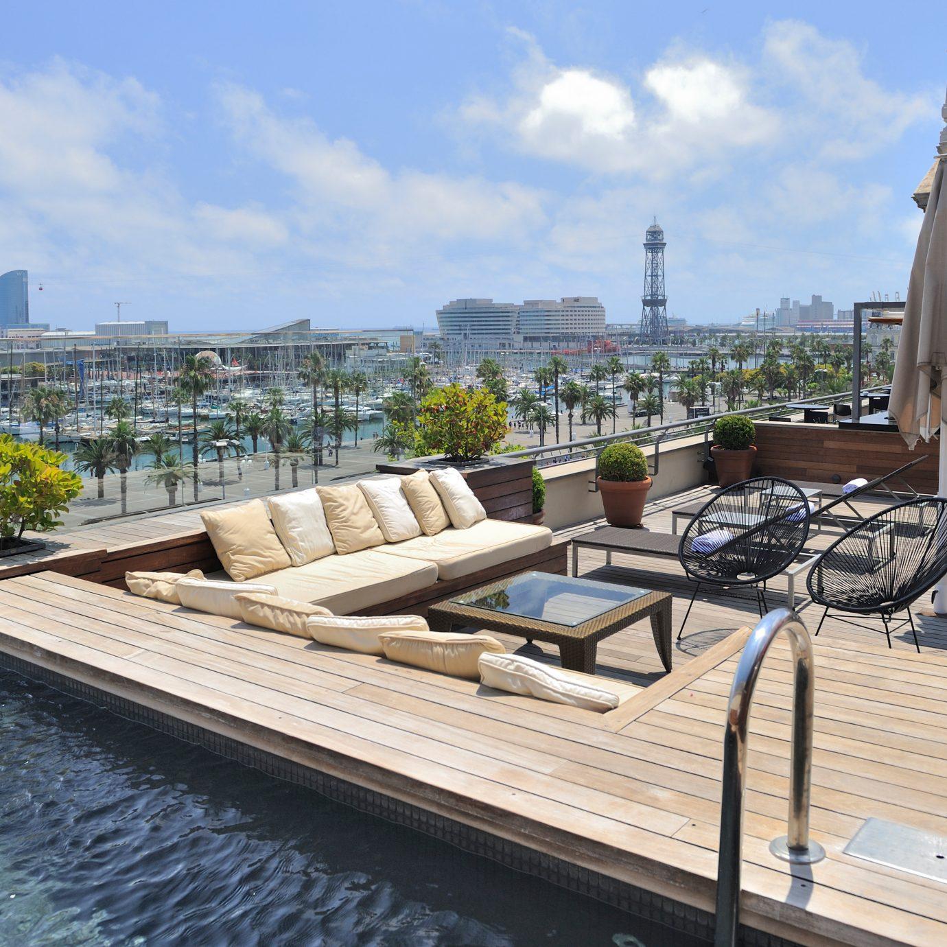 Deck Luxury Patio Pool sky property swimming pool walkway dock reflecting pool condominium waterway marina outdoor structure plaza