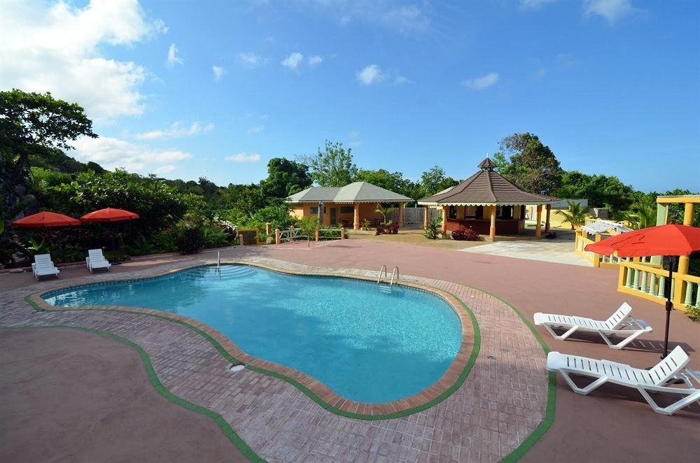 Outdoors Pool sky tree chair swimming pool property Resort leisure lawn Villa backyard condominium Deck set lined