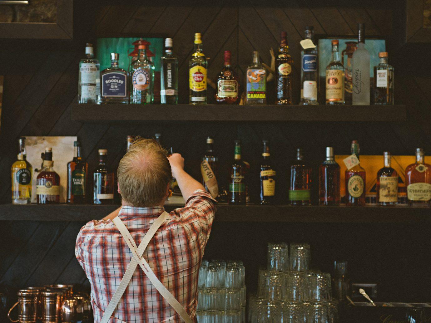 Alberta Canada Road Trips bottle person indoor Bar Drink alcohol sense distilled beverage drinking
