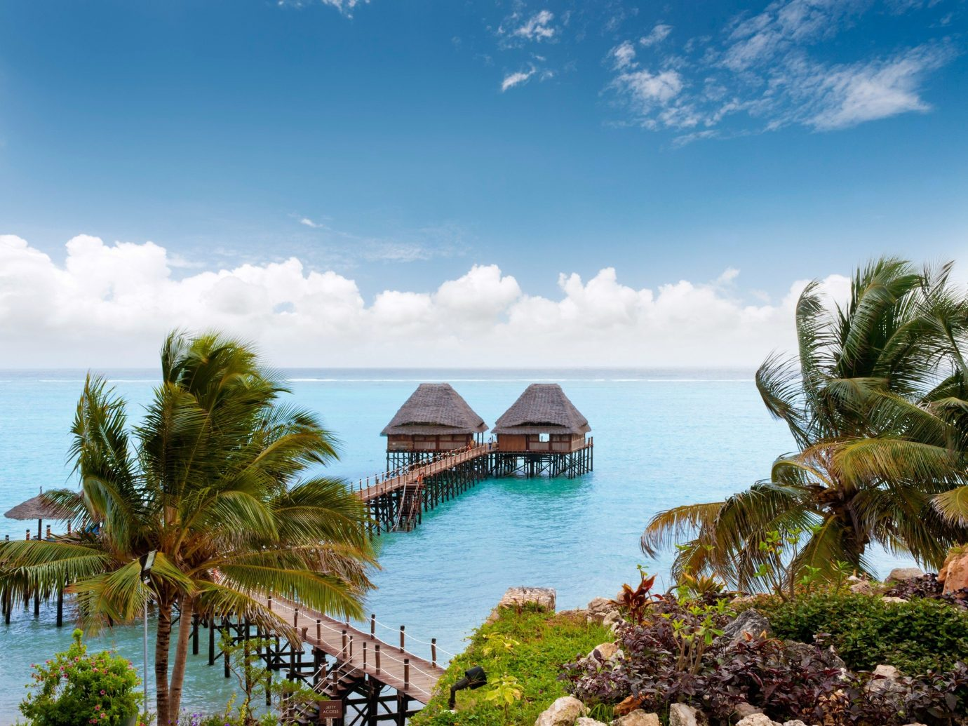 Hotels Offbeat water sky outdoor tree Sea Coast vacation Ocean caribbean Beach Resort tourism shore bay arecales Nature estate tropics Island Lagoon cove cape plant swimming several sandy day