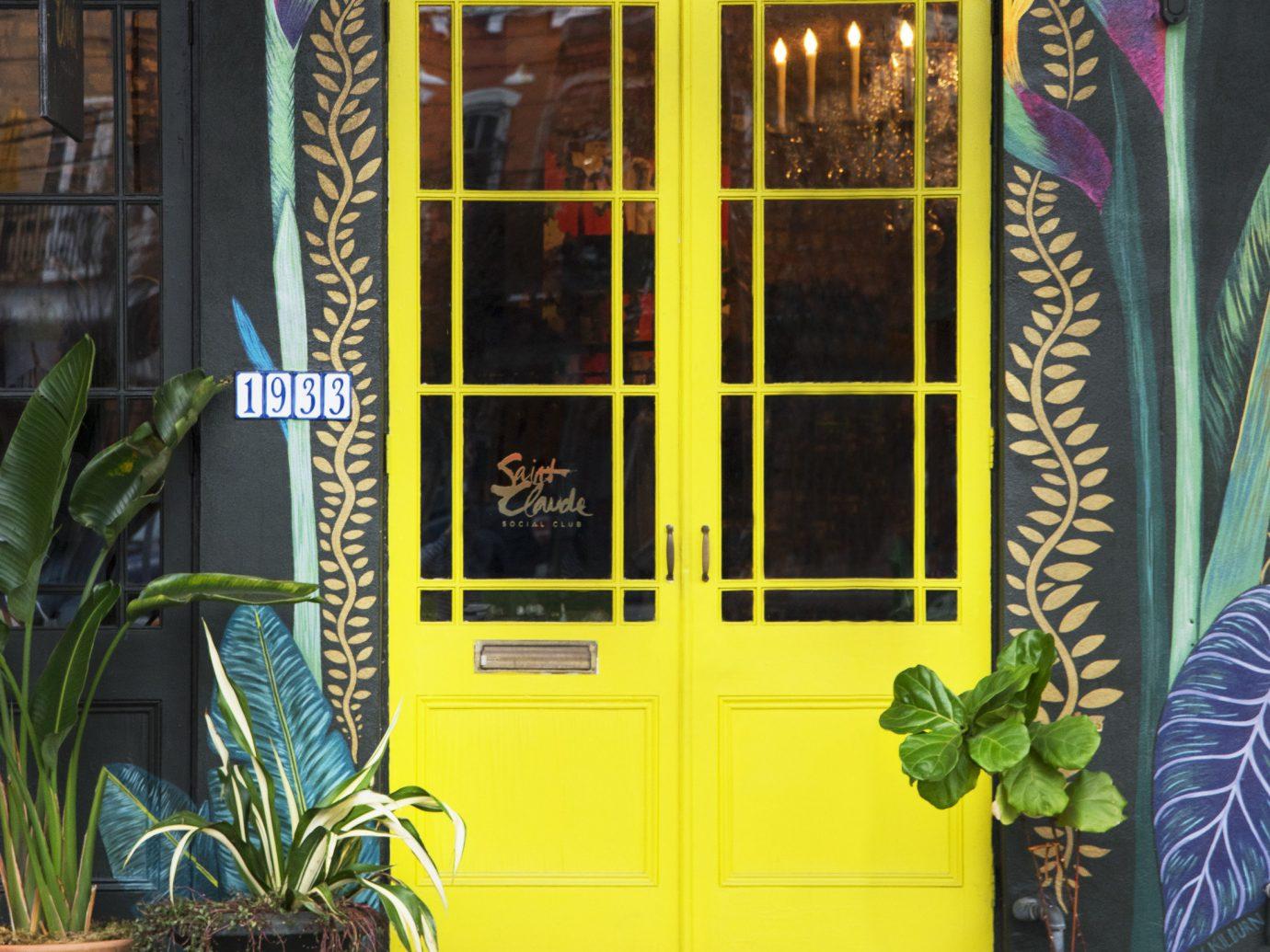 Girls Getaways New Orleans Trip Ideas Weekend Getaways yellow door window house facade plant