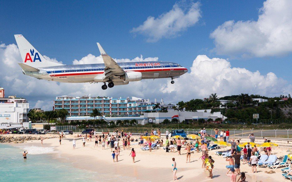 Offbeat sky outdoor airline vehicle airliner airplane people aircraft atmosphere of earth aviation jet aircraft wide body aircraft boeing shore several