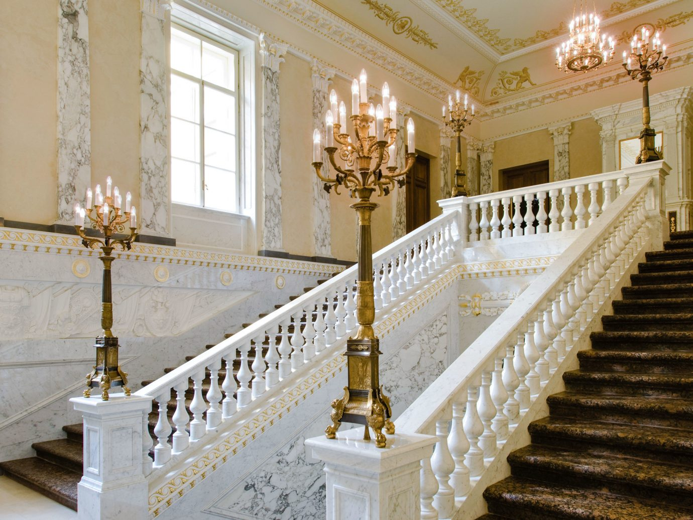 Hotels Luxury Travel baluster indoor stairs estate handrail home interior design tourist attraction aisle column molding house ceiling Lobby hall flooring window altar