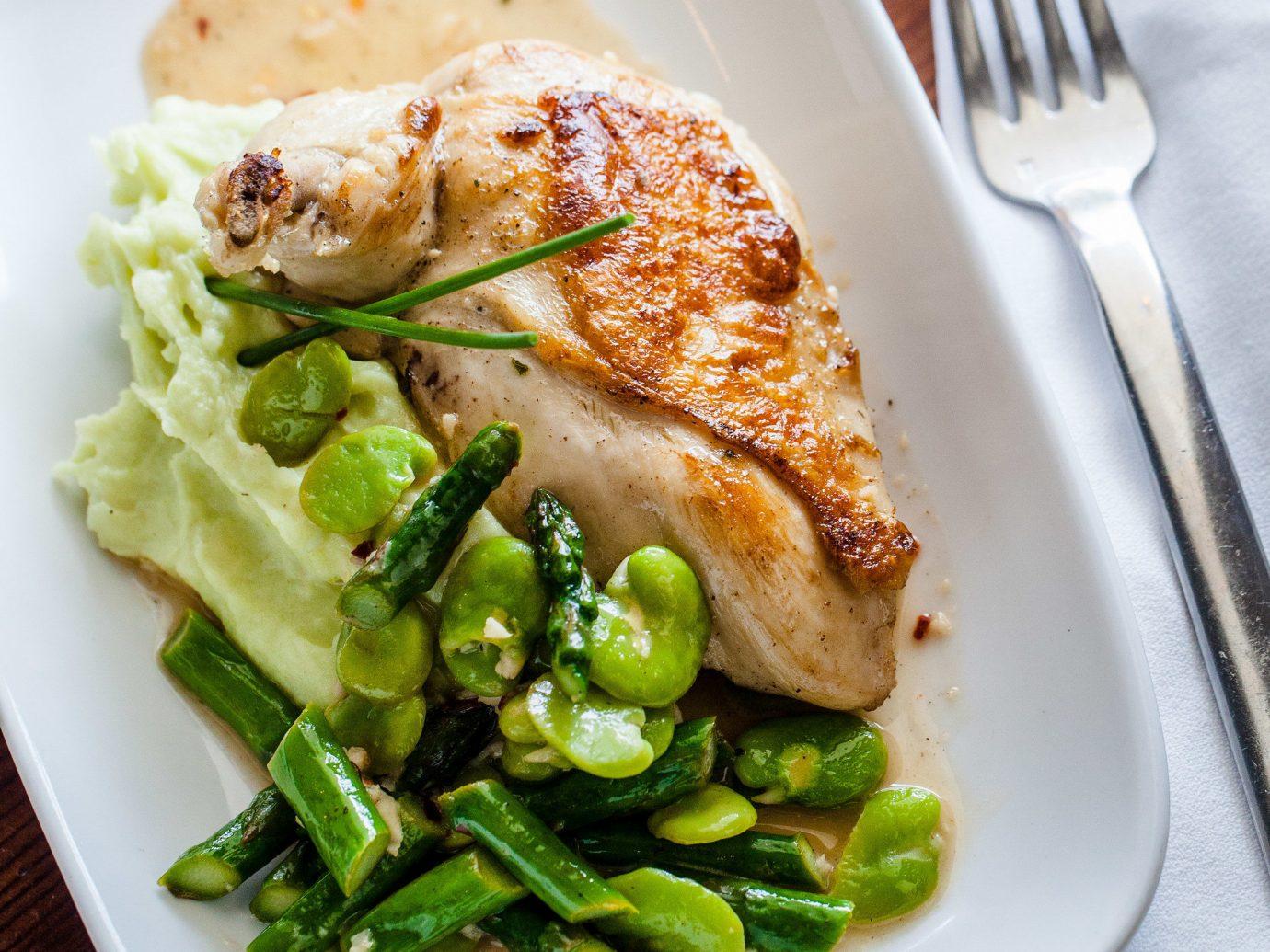 Trip Ideas plate food table dish indoor vegetarian food recipe vegetable meal meat piece de resistance