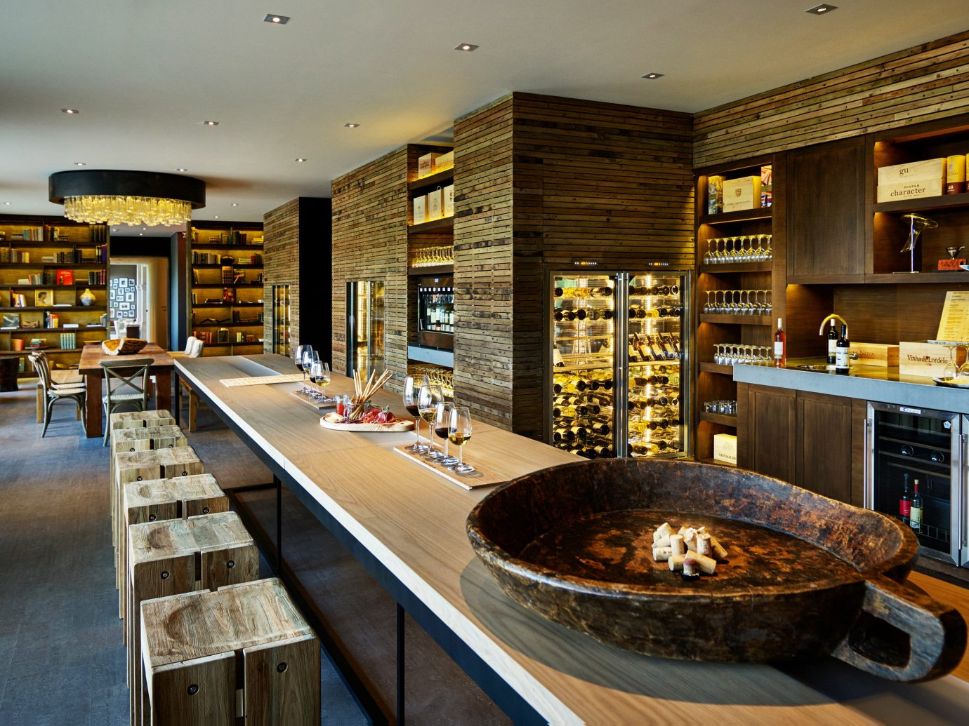 Bar Food + Drink Hotels indoor table Living ceiling building room bakery interior design restaurant estate home meal grocery store retail wood furniture Island
