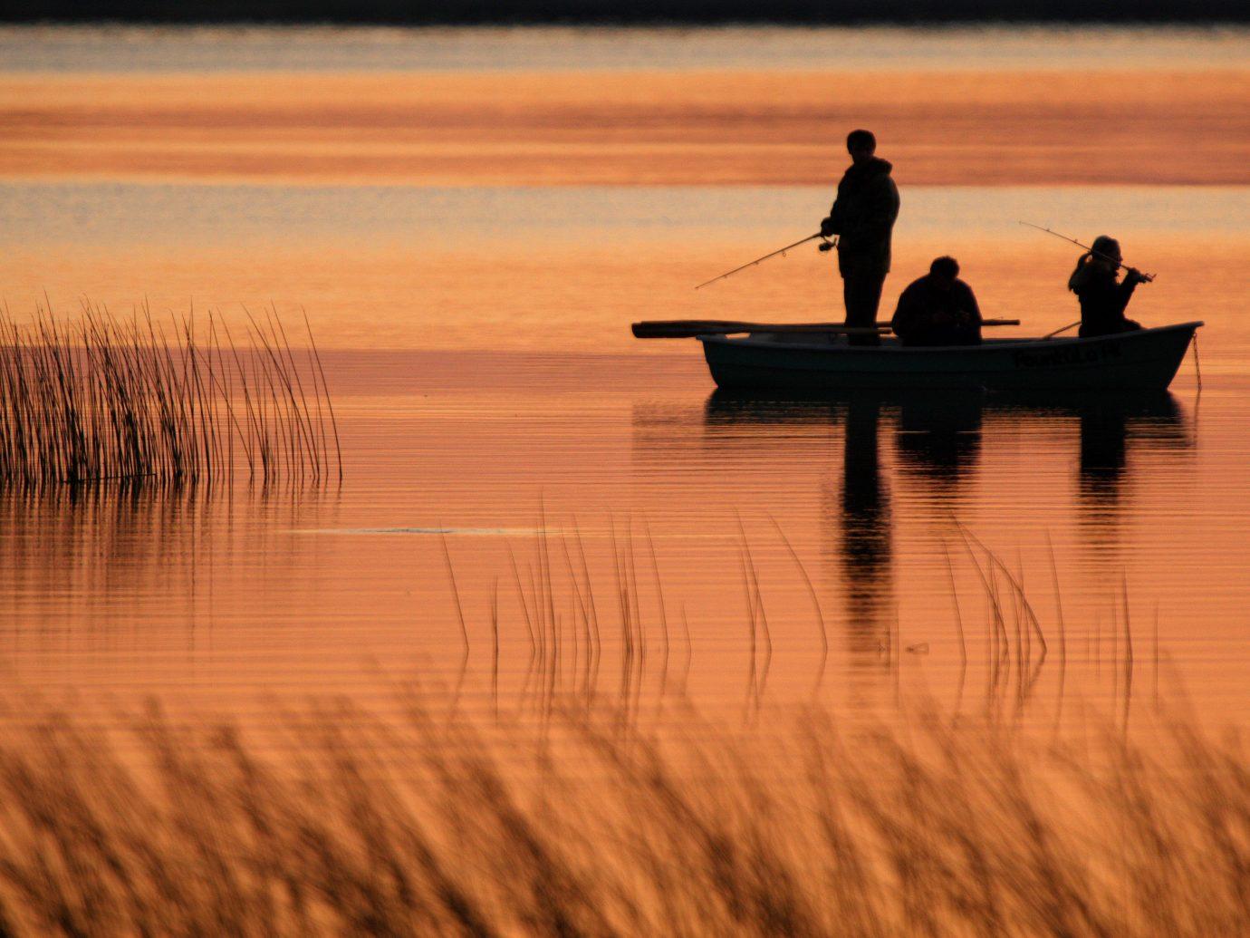 Offbeat outdoor water reflection Sunset atmospheric phenomenon horizon sunrise shore dawn morning Sea evening dusk sunlight Lake
