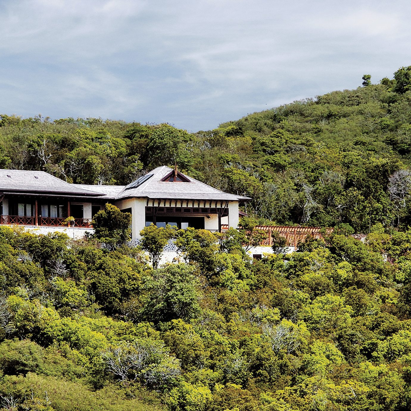 Exterior Island Jungle Resort Tropical tree sky mountain house hill rural area Forest landscape Village lush bushes hillside surrounded