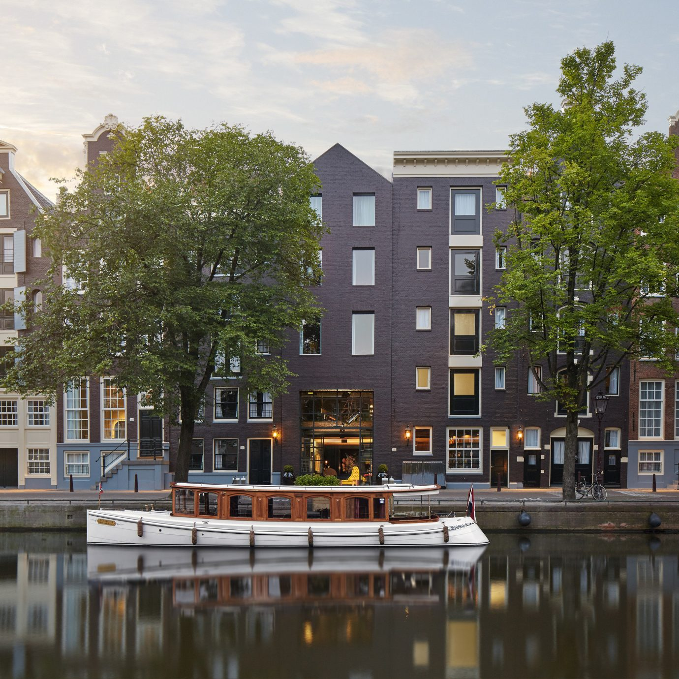 Amsterdam Boutique Hotels Hotels The Netherlands Trip Ideas outdoor sky water Canal City neighbourhood landmark Town urban area tower block waterway residential area reflection house cityscape human settlement Architecture Downtown River condominium facade town square skyline