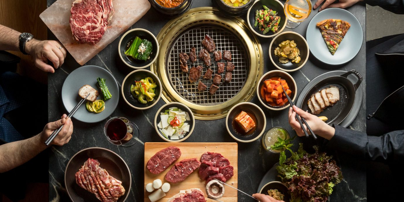 Food + Drink Hotels Trip Ideas food person dish plate cuisine group meal meat animal source foods vegetable recipe dinner different several